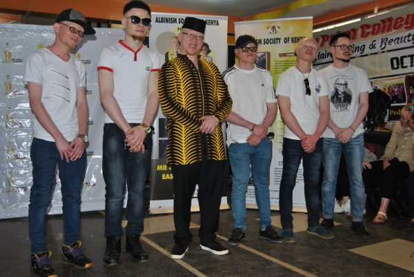 Sen. Isaac Mwaura (2-L) poses for a photo on Oct. 27, 2018, with male contestants.