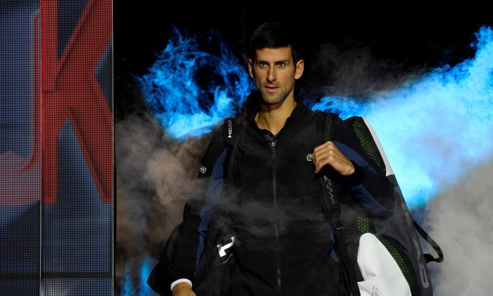 Serbia's Novak Djokovic makes his entrance for his group stage match against John Isner of the U.S.   on ATP Finals in London, Britain on Nov. 12, 2018. (Action Images via Tony O'Brien/Reuters)