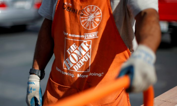 A Home Depot employee is seen outside a store in Los Angeles, California March 17, 2015. (Lucy Nicholson/File Photo/Reuters)