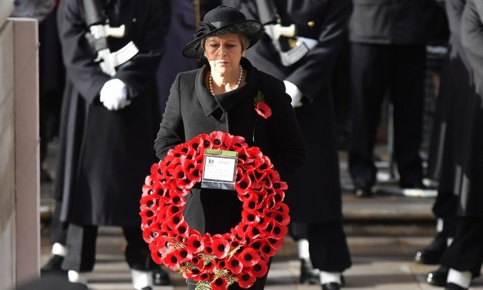 Britain's Prime Minister Theresa May lays a wreath at the Cenotaph during the Remembrance Sunday ceremony at the Cenotaph on Whitehall in central London, on Nov. 11, 2018  (BEN STANSALL/AFP/Getty Images)