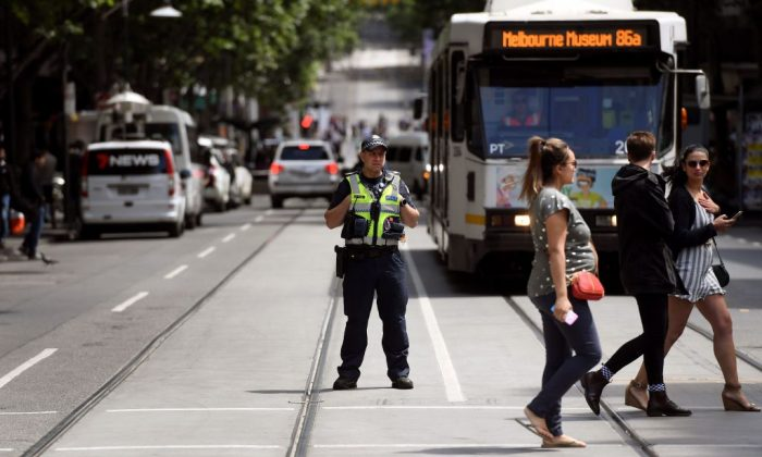 Police stand guard on Bourke Street. (William West/AFP/Getty Images)