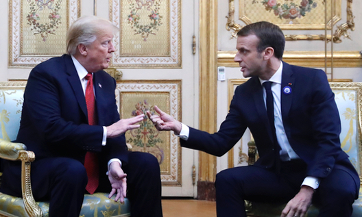 President Donald Trump and French President Emmanuel Macron gesture during their meeting inside the Elysee Palace in Paris Saturday Nov. 10, 2018.  (AP Photo/Jacquelyn Martin)