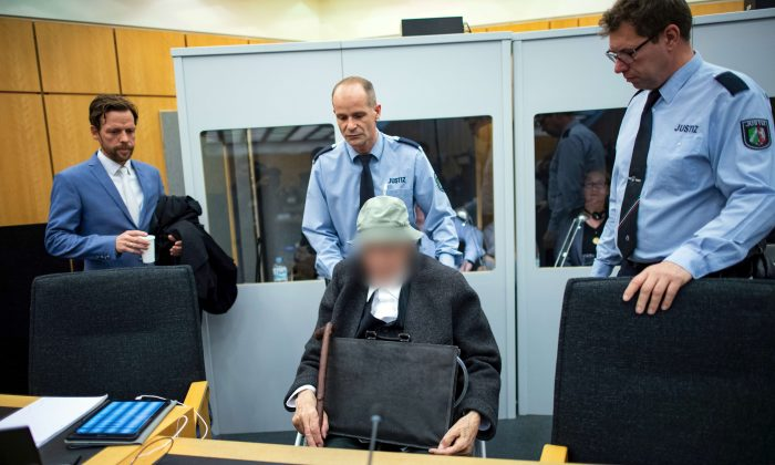 A 94-year-old German man accused of assisting in the murder of hundreds of people at a concentration camp during World War Two, pictured in court in Muenster, Germany, on Nov. 13, 2018. (Guido Kirchner/Pool via Reuters/File Photo)