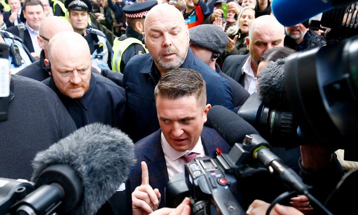 Activist Stephen Yaxley-Lennon, who goes by the name Tommy Robinson, leaves the Old Bailey after his contempt of court charge was referred to the Attorney General, in London on Oct. 23, 2018. (Reuters/Henry Nicholls/File Photo)