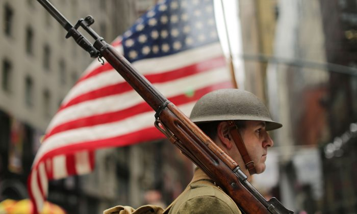 A World War I army re-enactor marches in the nation's largest Veterans Day Parade in New York City on Nov. 11, 2015. Following the end of World War I, a U.S. Army general, Harry Hill Bandholtz, helped to keep the peace in Hungary, preventing the National Museum from being looted by Romanian soldiers. He was part of a long tradition of U.S. peacekeeping.(Spencer Platt/Getty Images)