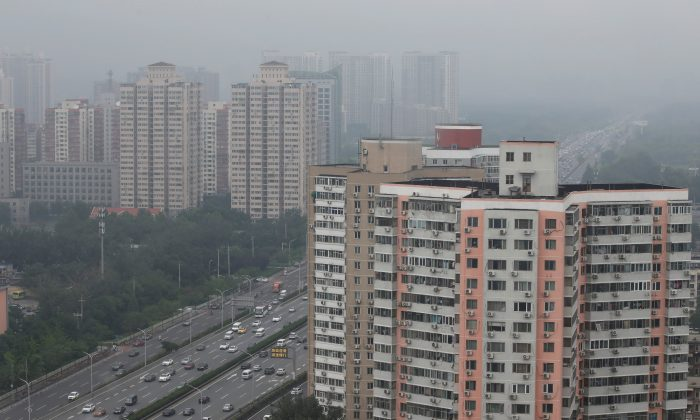 Residential buildings are seen along the Fourth Ring Road in Beijing, on July 16, 2018. (Jason Lee/Reuters)