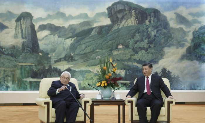 Chinese President Xi Jinping meets former U.S. Secretary of State Henry Kissinger at the Great Hall of the People, November 8, 2018 in Beijing, China. (Thomas Peter - Pool/Getty Images)