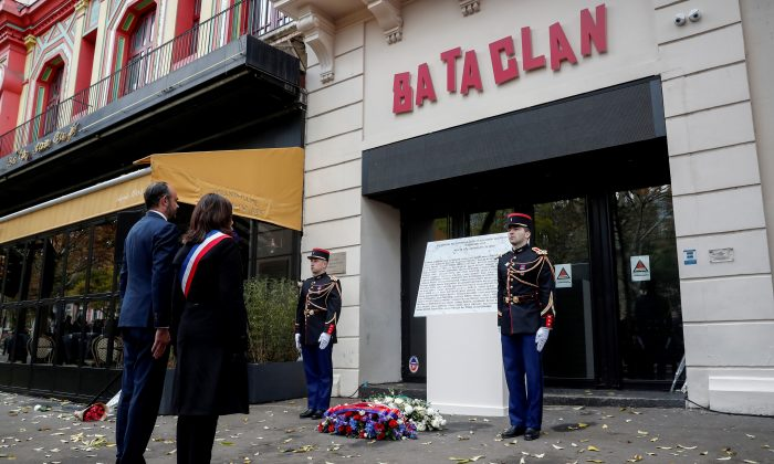 Paris Mayor Anne Hidalgo (R) and French Prime Minister Edouard Philippe stand in front a commemorative plaque at the entrance of the Bataclan in Paris on Nov. 13, 2018, during a ceremony held for the victims of the Paris attacks of November 2015. (Benoit Tessier/AFP/Getty Images)
