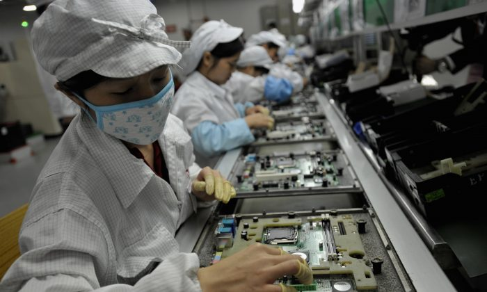 Chinese workers assemble electronic components at a factory in Shenzhen City, in Guangzhou Province, China, on May 26, 2010. (AFP/AFP/Getty Images)