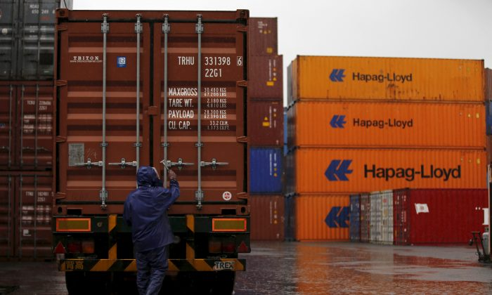 A man works at a container area at a port in Tokyo, Japan on Sept. 8, 2015. (Toru Hanai/File Photo/Reuters)