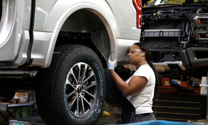A Ford Motor Company worker works on a Ford F150 truck on the assembly line at the Ford Dearborn Truck Plant in Dearborn, Michigan, on Sept. 27, 2018. (Bill Pugliano/Getty Images)