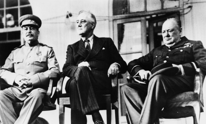 "The historic meeting of the ""Big Three"" in Tehran, Iran, in December 1943. (L–R) Soviet dictator Josef Stalin (1879–1953), U.S. President Franklin Delano Roosevelt (1882–1945), and British Prime Minister Winston Churchill (1874–1965). The three leaders met in person for the first time to discuss the co-ordination of Allied war efforts and the post-war aims of their respective countries.     (Keystone/Hulton Archive/Getty Images)"