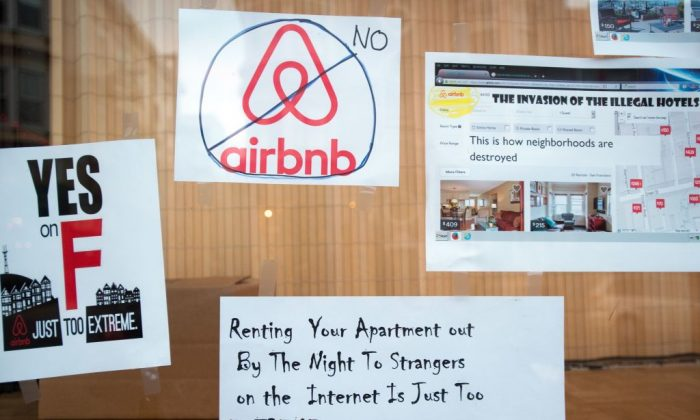 Signs showing support for Proposition F are posted on a shop window in San Francisco, Calif. in this file photo.  Proposition F, known to some as the Airbnb initiative, restricts short term rentals in the city (JOSH EDELSON/AFP/Getty Images)