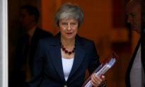 May Secures Draft Divorce Deal With EU, Faces Hostile UK Lawmakers