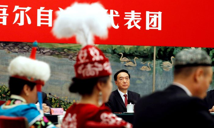 Xinjiang Uyghur Autonomous Region (XUAR) Party Secretary Chen Quanguo attends a group discussion session on the second day of the 19th National Congress of the Communist Party of China at the Great Hall of the People in Beijing on Oct. 19, 2017. (Tyrone Siu/Reuters)