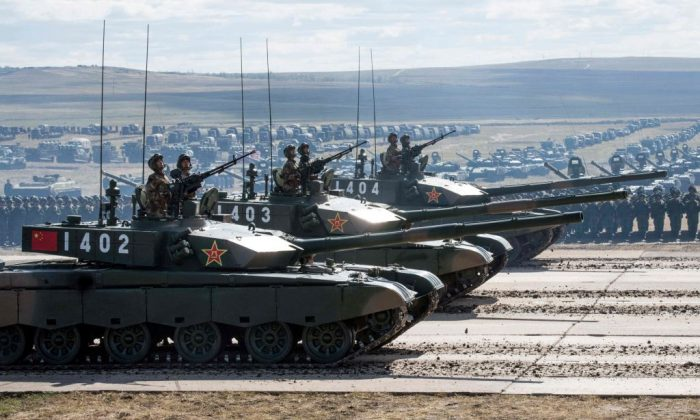 Chinese tanks parade not far from the borders of China and Mongolia in Siberia, on Sept. 13, 2018. (MLADEN ANTONOV/AFP/Getty Images)