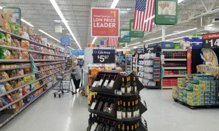 A shopper is seen in the aisle of a Walmart store in Woodstock, Georgia, U.S., June 28, 2018. Picture taken June 28, 2018. (Nandita Bose/File Photo/Reuters)