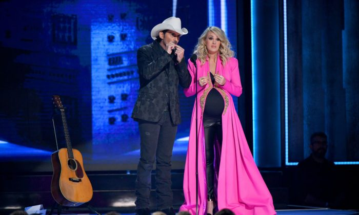 Brad Paisley and Carrie Underwood onstage during the 52nd annual CMA Awards at the Bridgestone Arena n Nashville, Tenn., on Nov. 14, 2018. (Michael Loccisano/Getty Images)