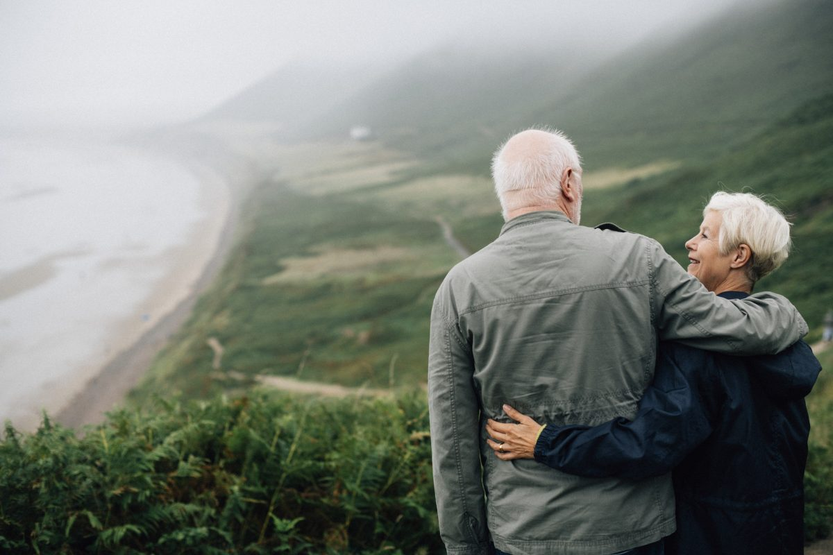 older couple look over bay and sea