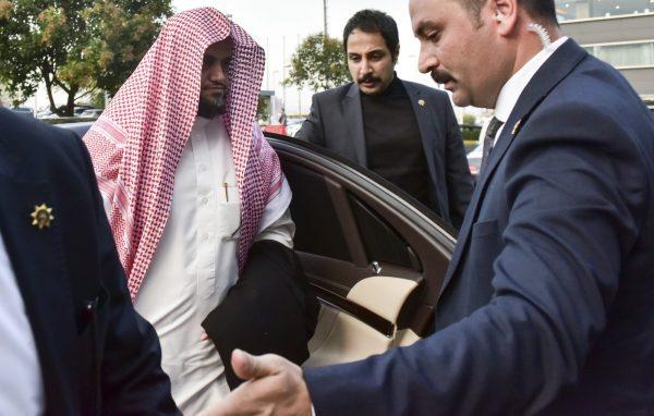 Saudi prosecutor getting out of a car