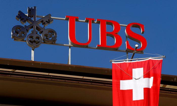 Switzerland's national flag flies under the logo of Swiss bank UBS in Zurich, Switzerland, on April 24, 2017. (Arnd Wiegmann/File Photo/Reuters)