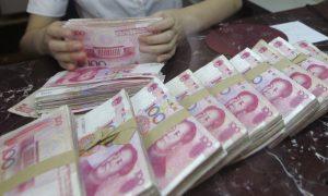 China's Yuan Slumps to 11-Year Low as US-China Trade War Escalates