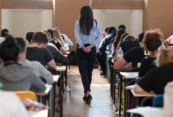 teacher walks through exam hall