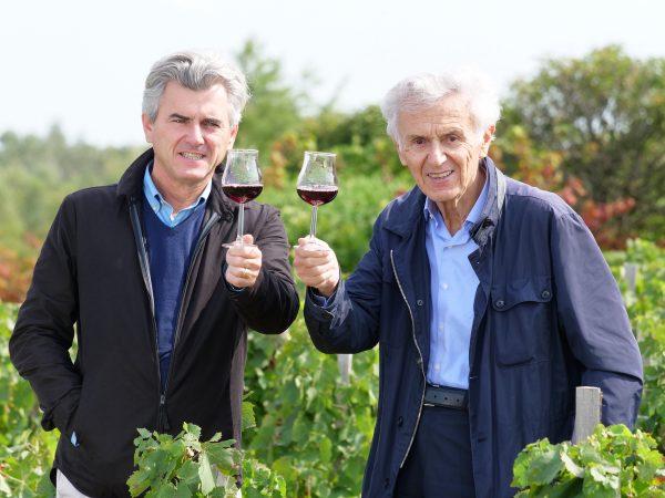 Georges and Franck Duboeuf raise wine glasses