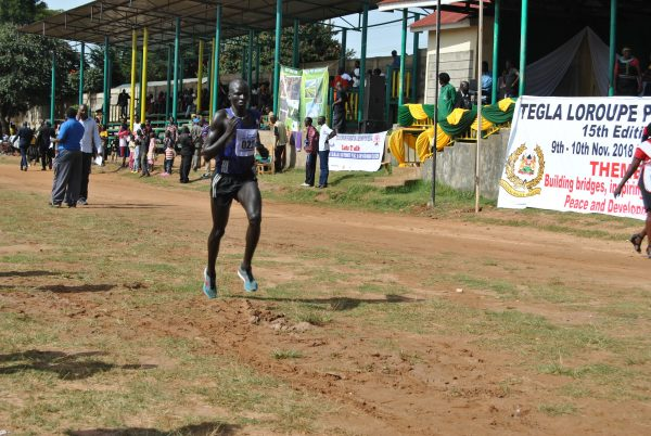 Pur Biel approaches the finish line after the 10km road race in Kepnguria, West Pokot County, Kenya.
