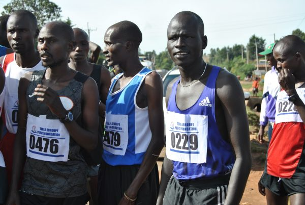Pur Biel (2-R) stands at the starting point before the 10km road race in Kepnguria, West Pokot County, Kenya.