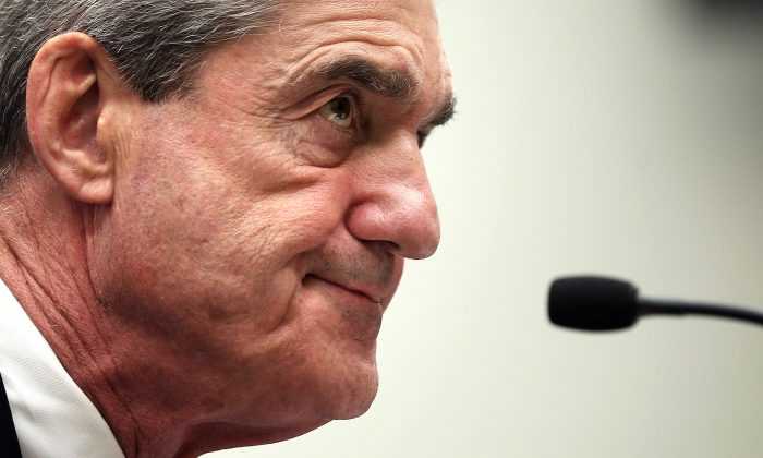 Federal Bureau of Investigation Director Robert Mueller testifies during a hearing before the House Judiciary Committee on Capitol Hill in Washington, on June 13, 2013. Mueller testified on the oversight of the FBI. (Alex Wong/Getty Images)