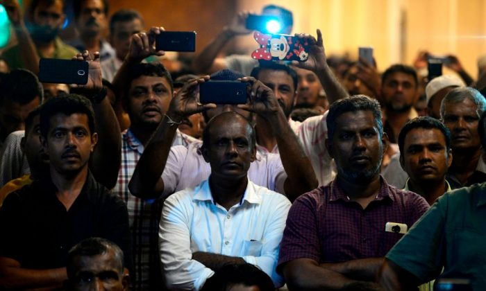 Supporters of ousted Sri Lanka's Prime Minister Ranil Wickremesinghe gather at the prime minister's official residence in Colombo early Nov. 10, 2018. (Lakruwan Wanniarachchi/AFP/Getty Images)