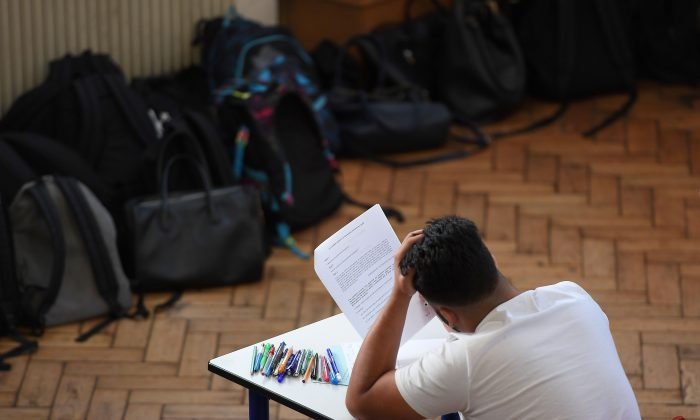 A student sits for a high school exam in Strasbourg, France, on June 18, 2018. (Frederick Florin/AFP/Getty Images)