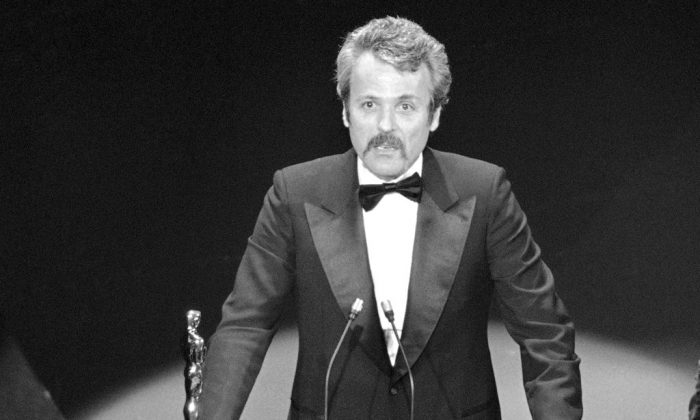"""William Goldman accepts his Oscar at Academy Awards in Los Angeles, for screenplay from other medium for """"All The President's Men."""" on March 28, 1977. Goldman, the Oscar-winning screenplay writer of """"Butch Cassidy and the Sundance Kid"""" and """"All the President's Men"""" William Goldman died, on Nov. 16, 2018. He was 87. (AP Photo, File)"""