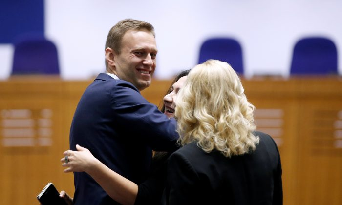 Russian opposition leader Alexei Navalny with his lawyers after the judgment regarding his case against Russia at the European Court of Human Rights in Strasbourg, France, on Nov. 15, 2018. (Vincent Kessler/Reuters)