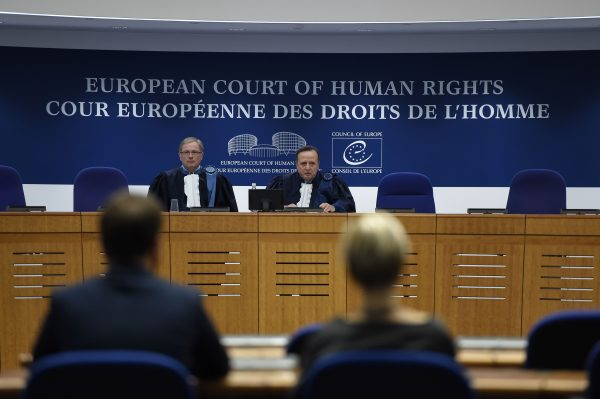 Russian opposition leader Alexei Navalny attends a hearing at the European Court of Human Rights