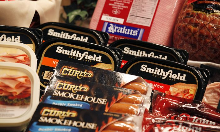 Some of the products of Smithfield Foods are displayed in front at a news conference on WH Group's IPO in Hong Kong on April 14, 2014. (Bobby Yip/Reuters)