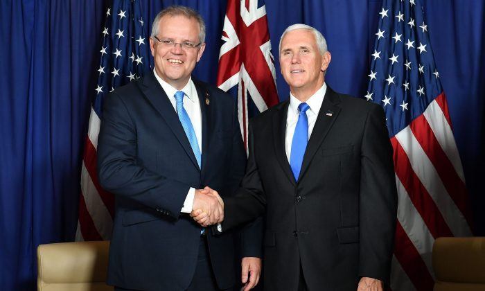 Vice President Mike Pence (R) shakes hands with Australia's Prime Minister Scott Morrison during a meeting in Port Moresby, on Nov. 17, 2018. (Saeed Khan/AFP/Getty Images)