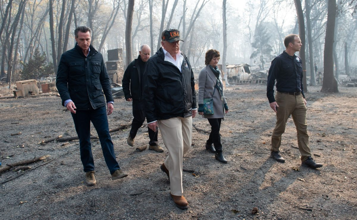 President Donald Trump (C) walks with Paradise Mayor Jody Jones (2nd R), Governor of California Jerry Brown (2nd L), Administrator of the Federal Emergency Management Agency, Brock Long (R), and Lieutenant Governor of California, Gavin Newsom, as they view damage from wildfires in Paradise