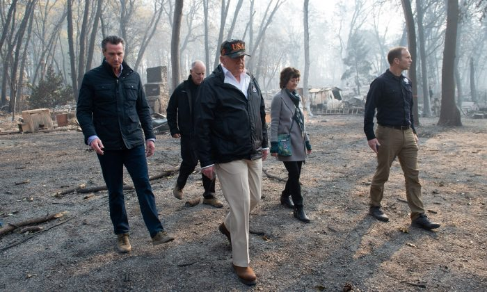 President Donald Trump (C) walks with Paradise Mayor Jody Jones (2nd R), Governor of California Jerry Brown (2nd L), Administrator of the Federal Emergency Management Agency, Brock Long (R), and Lieutenant Governor of California, Gavin Newsom, as they view damage from wildfires in Paradise, Calif., on Nov. 17, 2018. (Saul Loeb/AFP/Getty Images)
