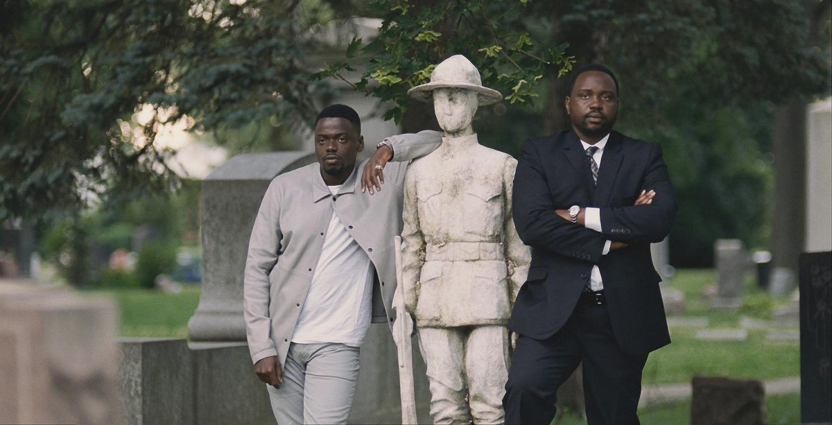 Daniel Kaluuya and Brian Tyree Henry in a graveyard
