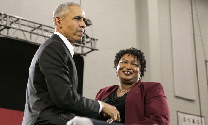 Former President Barack Obama stands with Georgia Democratic Gubernatorial candidate Stacey Abrams during a campaign rally at Morehouse College in Atlanta, Georgia on Nov. 2, 2018. Obama spoke in Atlanta to endorse Abrams and encourage Georgians to vote. (Jessica McGowan/Getty Images)