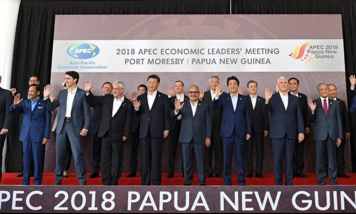 """APEC leaders pose for a """"family photo"""" during the Asia-Pacific Economic Cooperation (APEC) Summit in Port Moresby on Nov. 18, 2018. (SAEED KHAN/AFP/Getty Images)"""