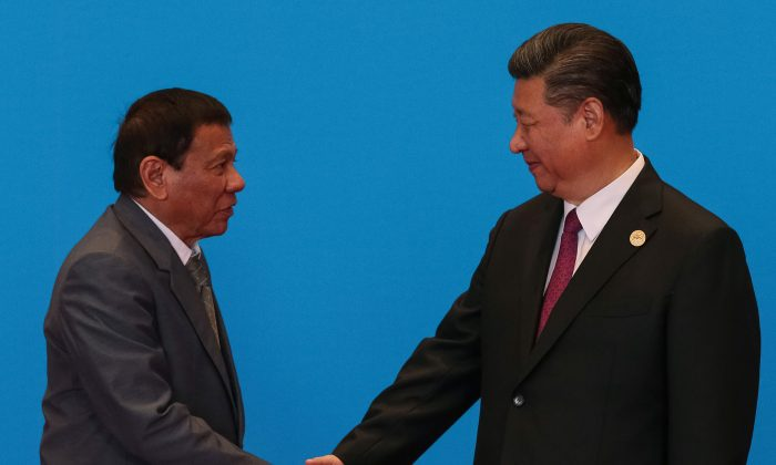 Chinese leader Xi Jinping shakes hands with Philippine President Rodrigo Duterte as they attend the welcome ceremony at Yanqi Lake during the Belt and Road Forum in Beijing on May 15, 2017. (Roman Pilipey/Reuters)