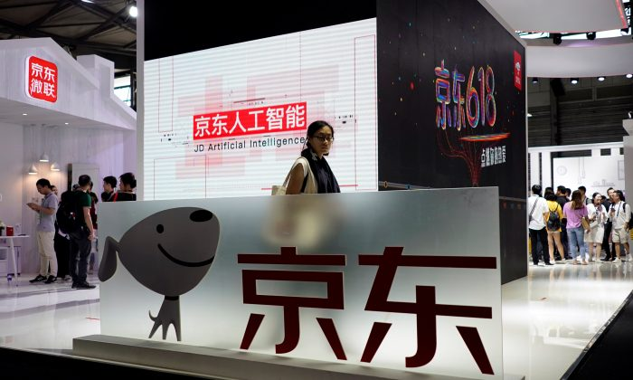 A sign of China's e-commerce company JD.com is seen at CES (Consumer Electronics Show) Asia 2018 in Shanghai, China on June 14, 2018. (Aly Song/ Reuters)