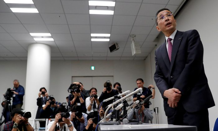 Nissan President and Chief Executive Officer Hiroto Saikawa arrives to attend a news conference after Japanese media reported that Nissan Chairman Carlos Ghosn will be arrested on suspicion of under-reporting his salary, at the company headquarters in Yokohama, south of Tokyo, Japan on Nov. 19, 2018.  (Issei Kato/Reuters)