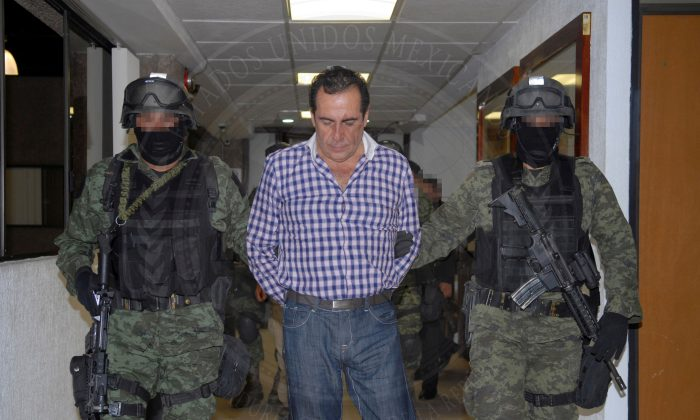 Soldiers escort head of the Beltran Leyva drug cartel Hector Beltran Leyva in Mexico City, in this handout picture taken on Oct. 1, 2014. (Attorney General's Office/Handout/Reuters)