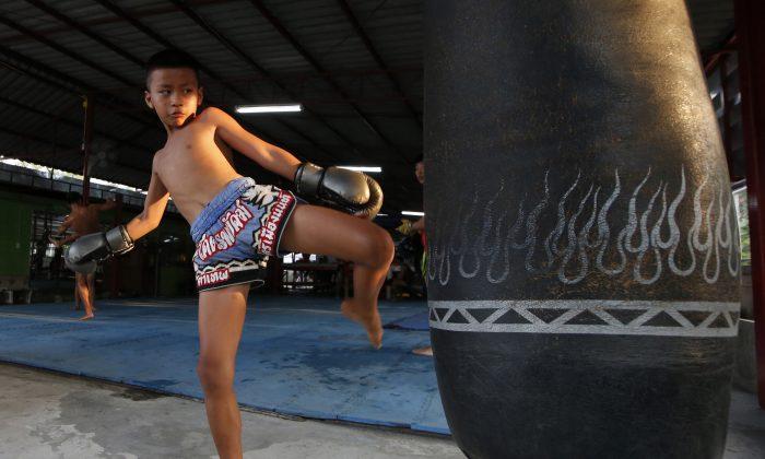 Thai kickboxer Chaichana Saengngern, 10, practices kicks at a training camp in Bangkok, Thailand, on Nov. 14, 2018. (Sakchai Lalit/AP)