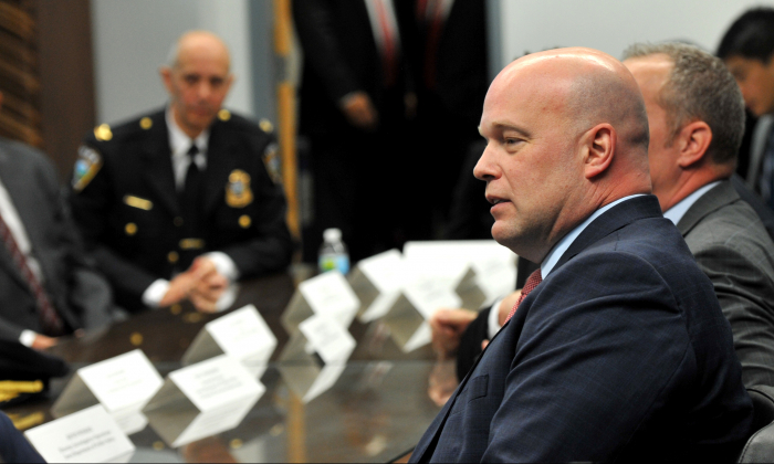 Acting Attorney General Matthew G. Whitaker,  gives brief remarks to state and local law enforcement on efforts to combat violent crime and the opioid crisis at the U.S. Courthouse Annex, in Des Moines, Iowa, on Nov. 14, 2018. (Steve Pope/Getty Images)