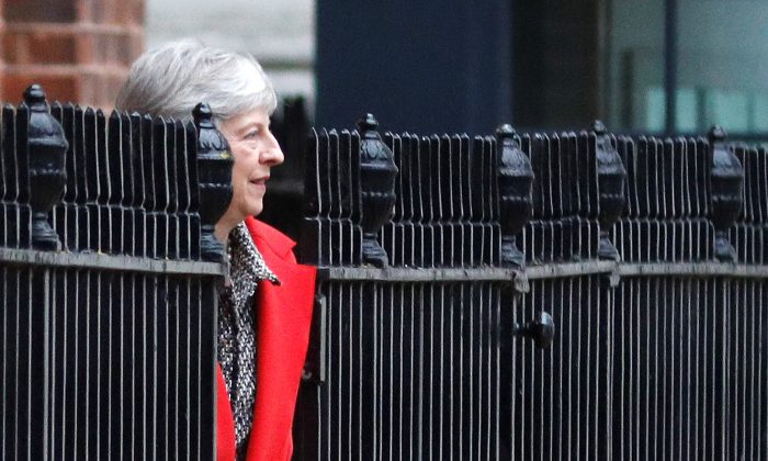 Britain's Prime Minister Theresa May leaves 10 Downing Street via the back exit in London on Nov. 16, 2018. (Reuters/Peter Nicholls)